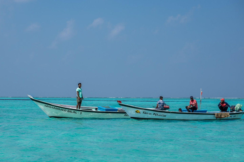 Boats in turquoise water, Bangaram, Lakshadweep, India.
