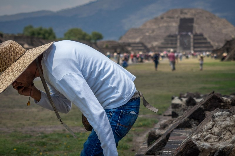 Man in a sombrero hat taking a rest, Teotihuacan, Mexico.