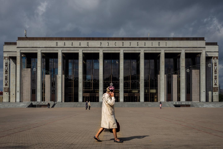 Woman walking cross October Square, Minsk, Belarus.