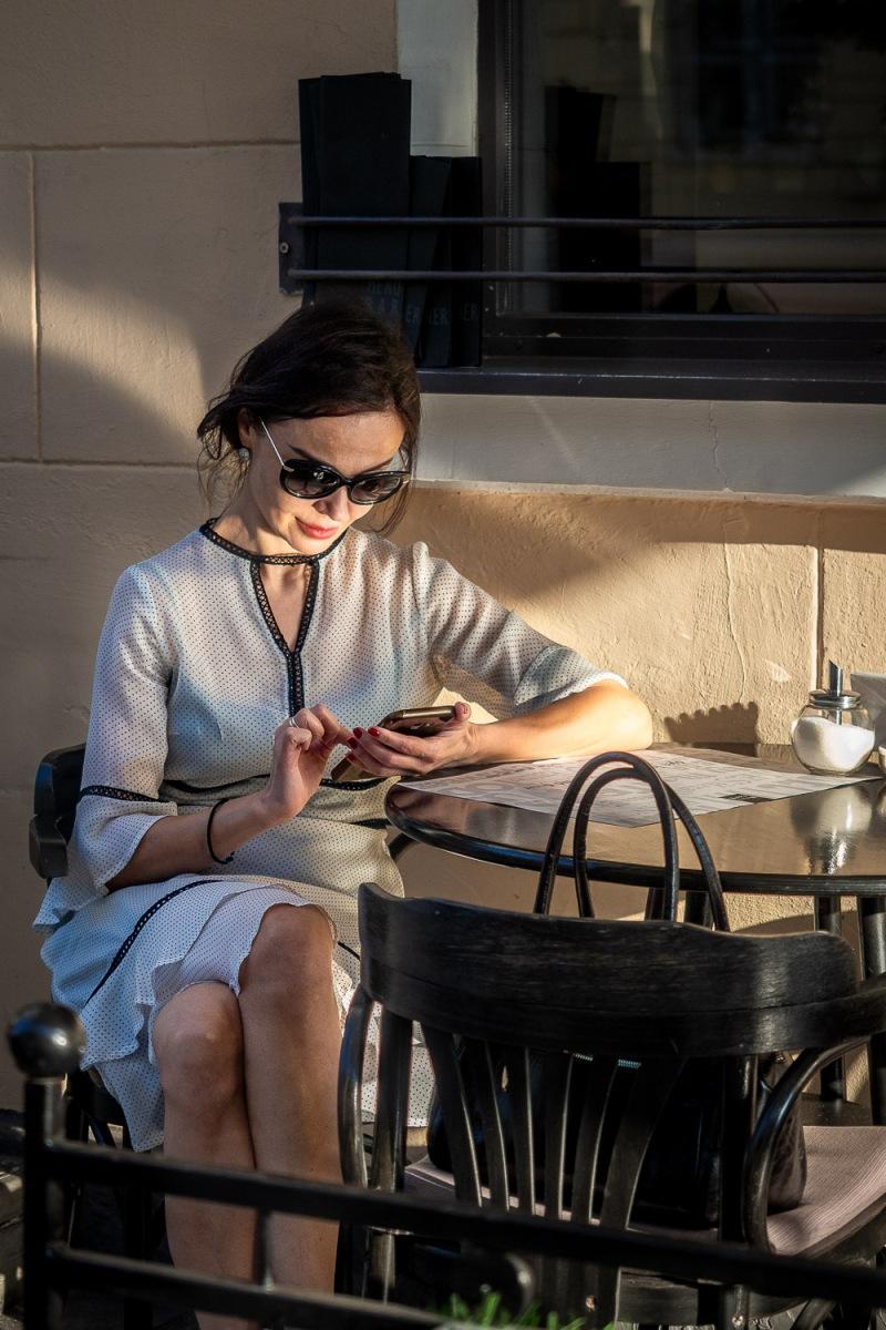 Woman at a café on Karla Marksa Street, Minsk, Belarus.