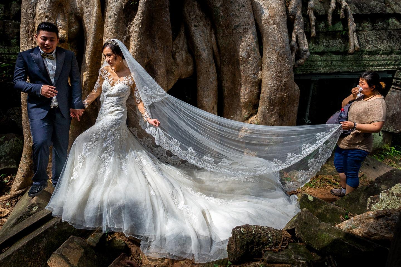 Wedding ceremony at Ta Phrom, Angkor, Cambodia.
