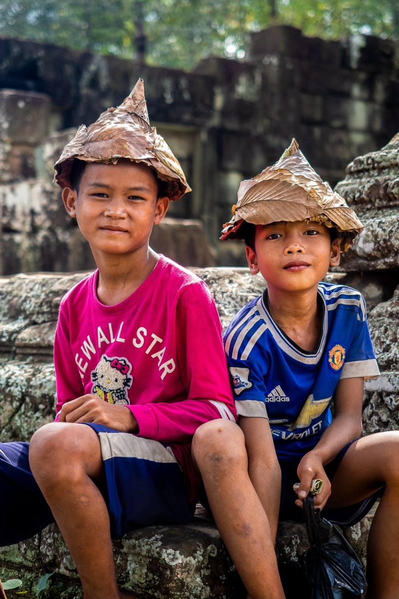 Boys with leaf hats, Angkor Wat, Cambodia.