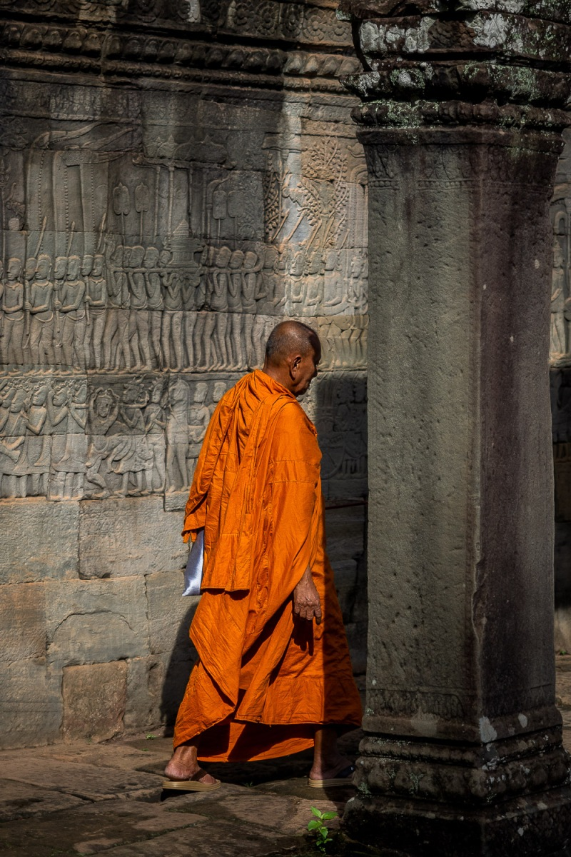 Monk visiting the sanctuary temples, Angkor, Cambodia.