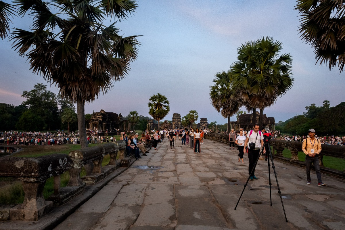 Visitors waiting for the sun to rise, Angkor, Cambodia.