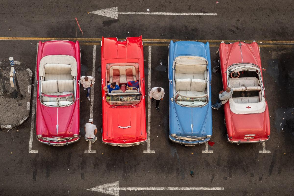 Men looking after their cars, Havana, Cuba.