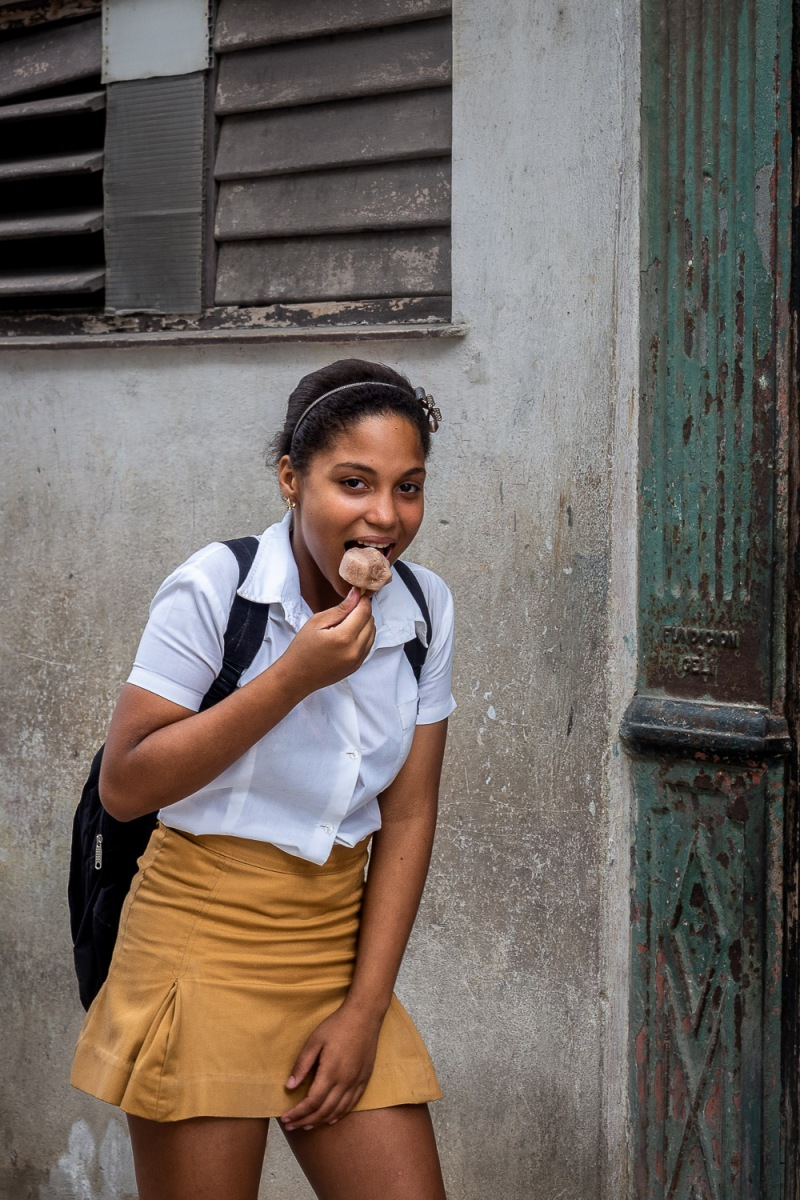Girl eating ice cream, Havana, Cuba.