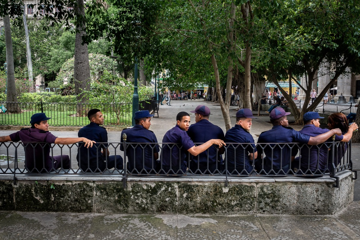 Police officers taking a rest in a park, Havana, Cuba.