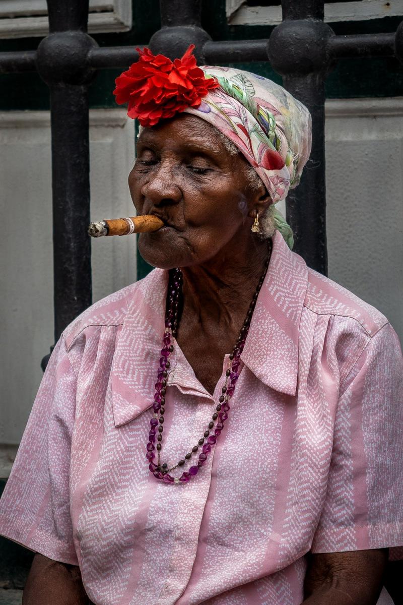 Woman smoking cigar, Havana, Cuba.