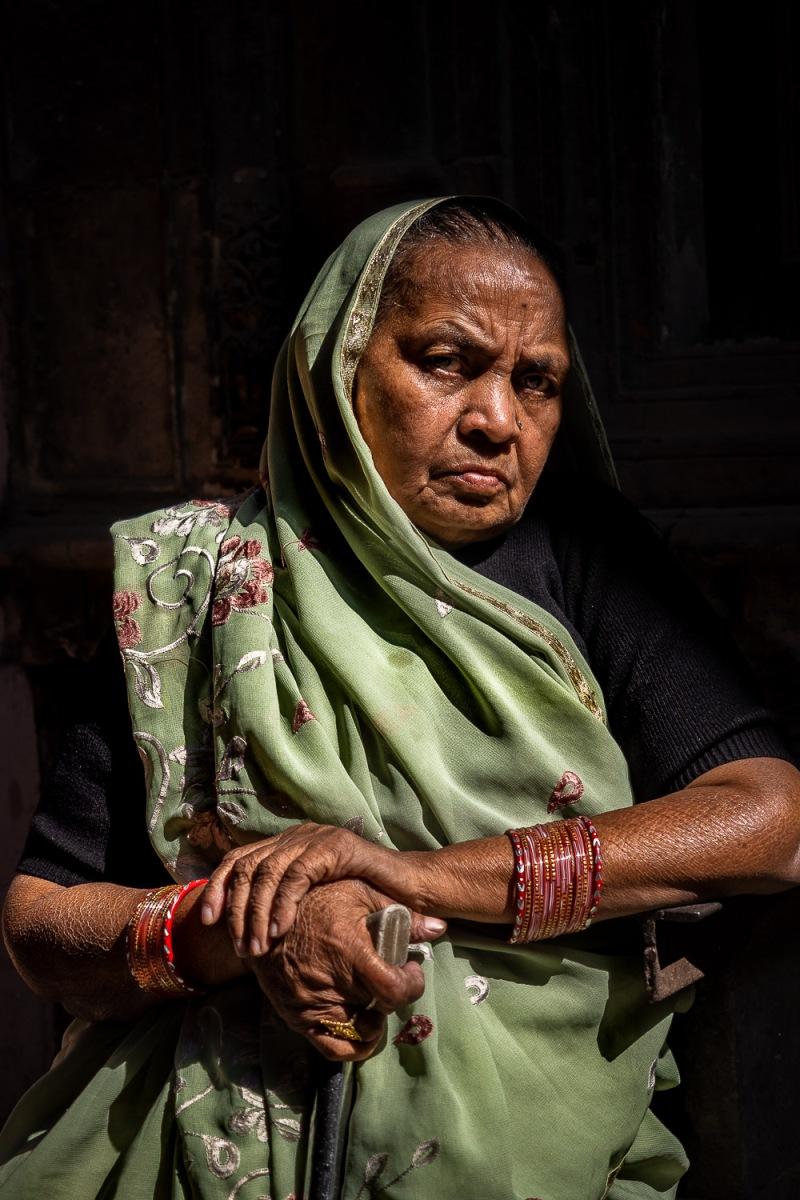 Woman in a long green scarf, Old Delhi, India.
