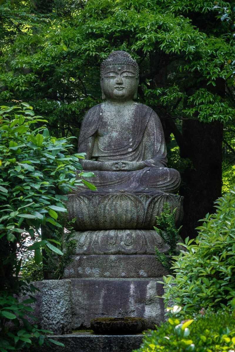 Buddha at the Golden Pavilio, Kyoto, Japan.