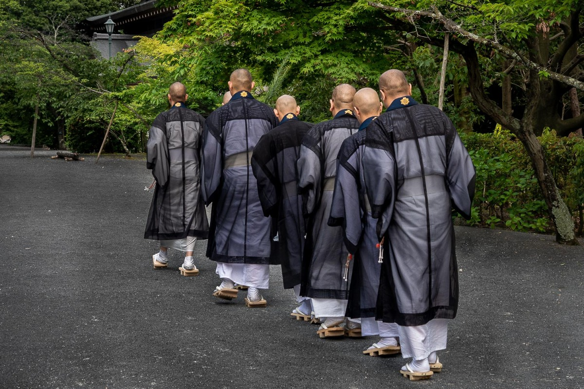 Monks at the Ninna-ji pagoda, Kyoto, Japan.