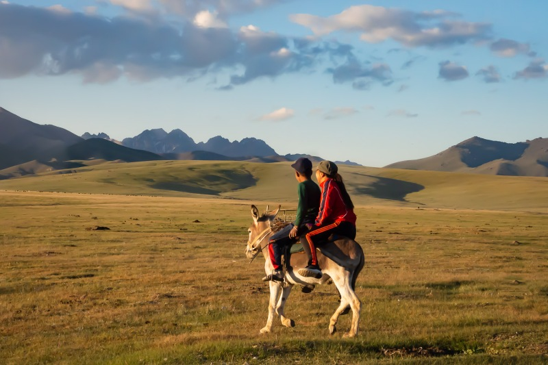 Riding in the sunset, Song-Kul Lake, Kyrgyzstan.