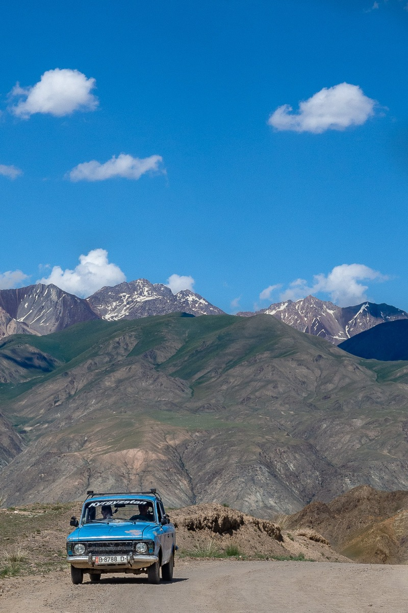 Old East German Trabant passing by passing, Tian Shan, Kyrgyzstan.
