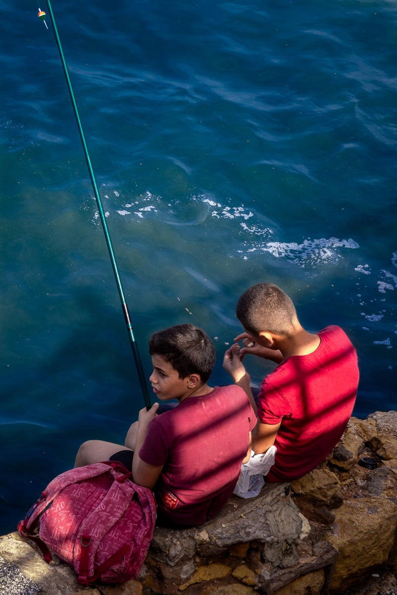 Two boys fishing, La Corniche, Beirut, Lebanon.