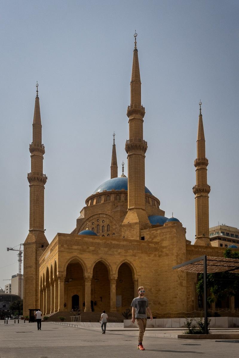 Man young passing the Muhammad Al-Amin mosque, Beirut, Lebanon.