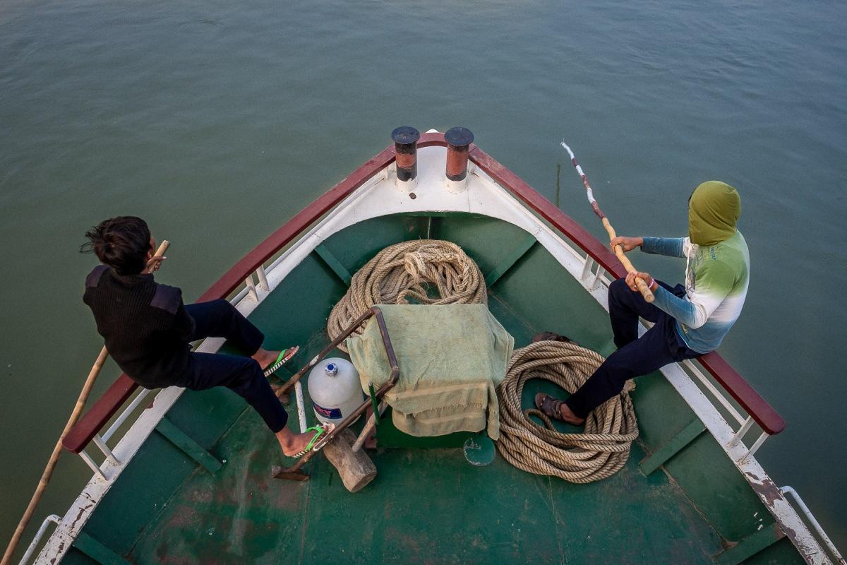 Boys measuring the depth, Irrawaddy River, Myanmar.