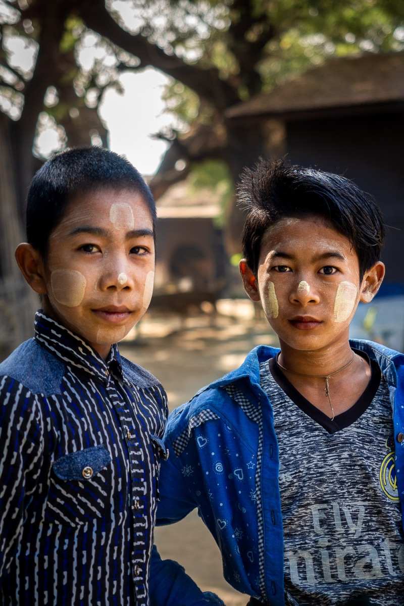 """Two boys with traditional """"thanaka"""", a white paste made of tree bark, Lekkapin Village, Myanmar."""