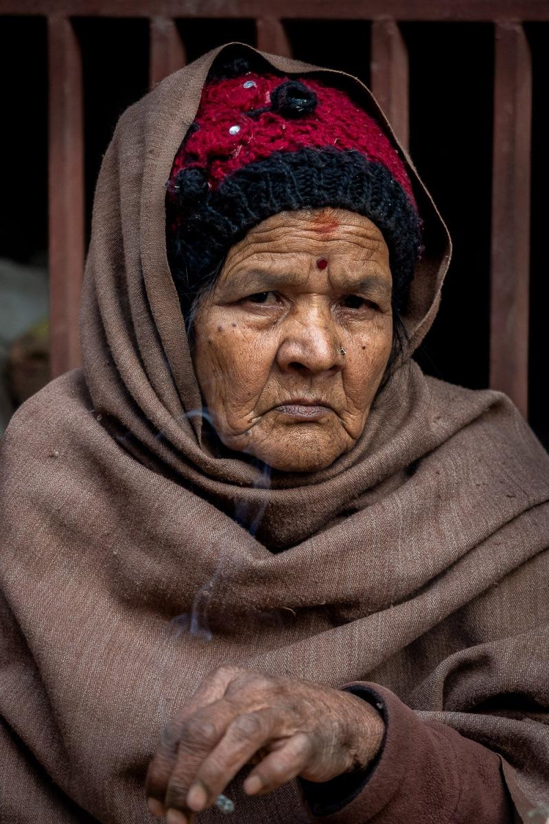 Woman smoking a cigarillo, Kathmandu, Nepal.