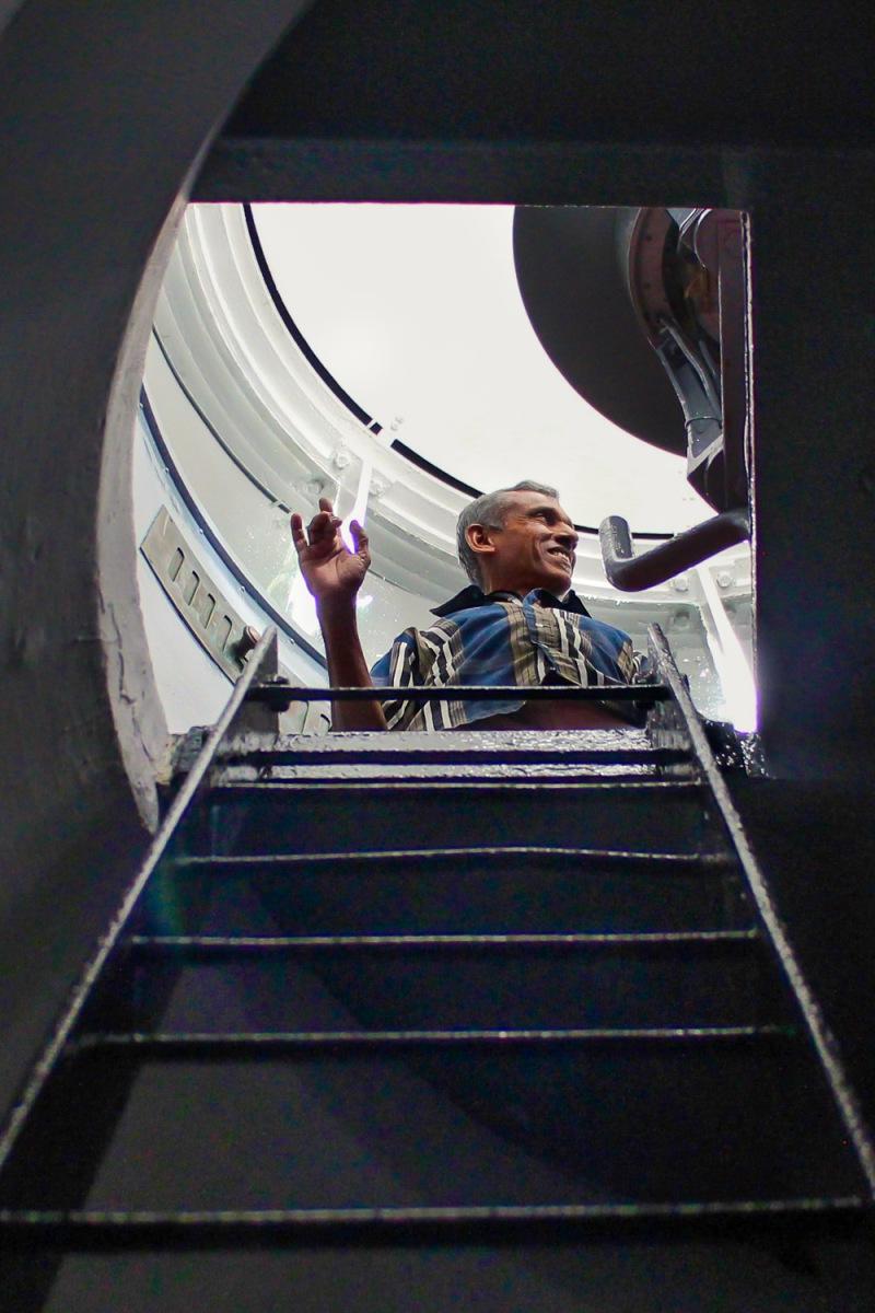 Lighthouse keeper managing the lamp system, Galle, Sri Lanka.