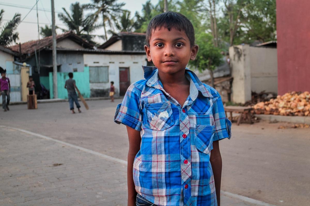 Children playing cricket, Negombo, Sri Lanka.