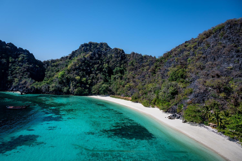 Turquoise water surrounding a beach in Mergui Archipelago, Myanmar.
