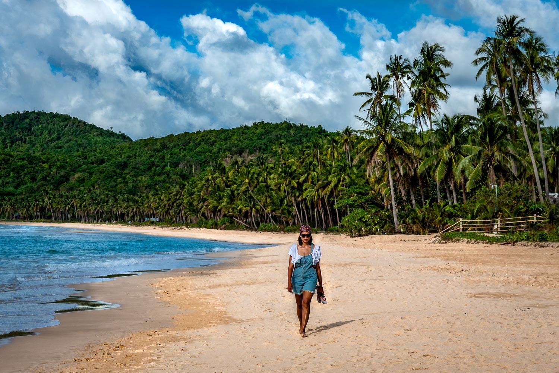 Travelgrapher.com-Relocate-Philippines-Palawan-El-Nido-Nacpan-Beach-Girl