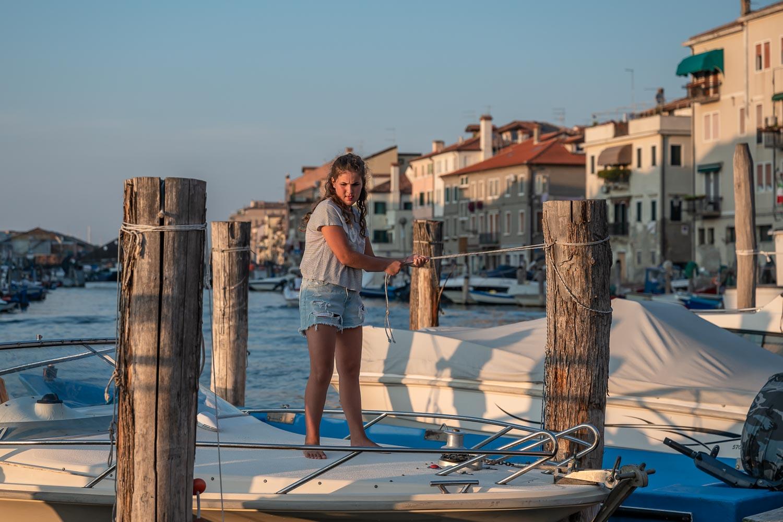 Travelgrapher.com-Inspire-Italy-Chioggia-Harbour-Girl