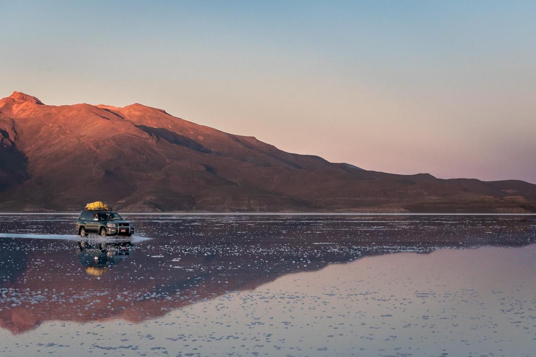 Bolivia-Uyuni-Salt-Flats-Reflections-Sunrise-Car-On-Water